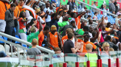 Dancing fans from Ivory Coast on match at Lokomotiv Stadium. - stock footage