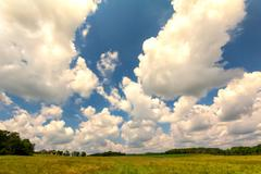 Puffy Cumulus Clouds Over the Countryside Stock Photos