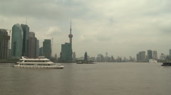 Tracking along river, central Shanghai Stock Footage