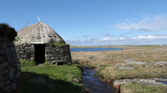 Exterior of reconstructed Norse Kiln Isle of Lewis Scotland Stock Footage