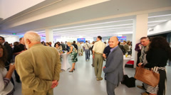 People at tables during photo exhibition Atomic Civilization Stock Footage