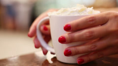 Hands put white cup of cappuccino on table and take it again Stock Footage