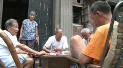 Stock Video Footage of Card players gamble in the street 2