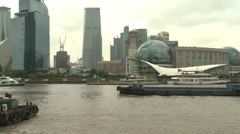Busy river scene, central Shanghai behind - stock footage