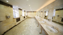 Toilet with marble flooring and countertops for stylish sinks Stock Footage