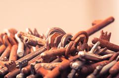 A large group of rusty keys - stock photo