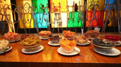 Plates with dried fruits, nuts, hookahs in restaurant Stock Footage