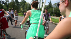 Two girls on tandem on cycle parade Lady on Bicycle Stock Footage