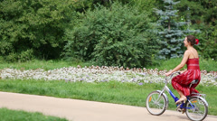 Young woman participant rides bike of cycle parade Lady Stock Footage