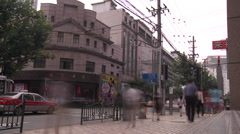 Timelapse of people walking on a sideway/pavement in China Stock Footage