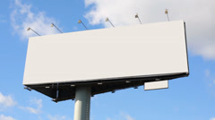 Blank billboard at background of blue sky with moving clouds Stock Footage