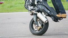 Biker stunt shows on motorcycle on Festival. Stock Footage