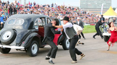 Fight near retro cars at Festival of art and film stunt Stock Footage