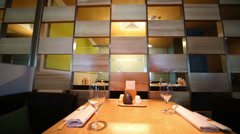 Partition and table appointments in cafe with modern interior Stock Footage