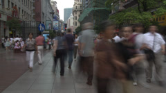 Timelapse of a busy pavement/sidewalk in China Shanghai Stock Footage