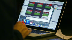 Photographer edits photos in press room after game Stock Footage
