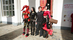 Women in latex suits and boy at festival Everycon Stock Footage