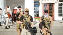 Soldiers go at festival Everycon near House of Culture in VVC. Stock Footage