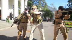 Soldiers run at festival Everycon near House of Culture in VVC. Stock Footage