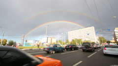 Cars on street and double rainbow in Moscow. Stock Footage