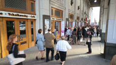 People walk near Tchaikovsky Concert Hall in Moscow. - stock footage