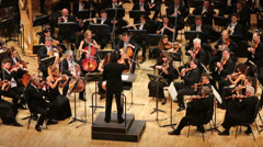 Conductor and musicians in Tchaikovsky Concert Hall. - stock footage