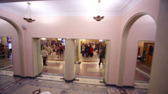 People in cloakroom in Tchaikovsky Concert Hall. - stock footage