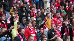 Spartak fans shout at football match Spartak Moscow - Dynamo Kiev Stock Footage
