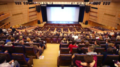 Auditorium and stage before show Judgment Day on Large hall Stock Footage
