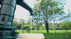 Water dripping from an old well pump - stock footage