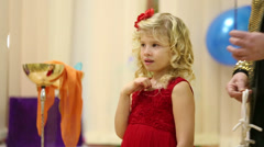 Girl with magic wand and hands of entertainer on children party Stock Footage