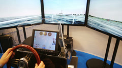 Steering wheel of boat simulator at VI International Exhibition Stock Footage