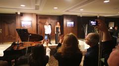 Vladimir Presnyakov and Natalia Podolskaya sing after Conference Stock Footage