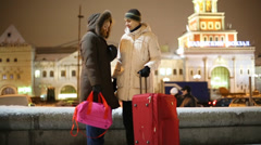 Man and woman with big bag look at watch and go away Stock Footage