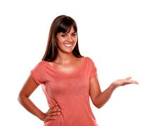 Smiling young female with the palm upward Stock Photos