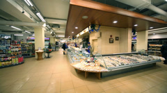 Seller and counter in supermarket of home food Bahetle Stock Footage