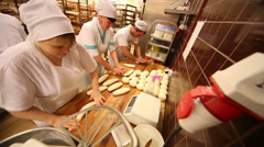 Workers knead dough in supermarket of home food Bahetle Stock Footage