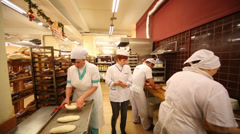Workers cook baking in supermarket of home food Bahetle Stock Footage