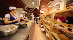 Workers and buyers in supermarket of home food Bahetle Stock Footage