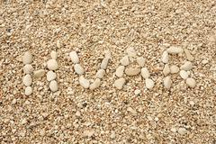 HVAR word made of pebbles, authentic picture of Hvar's beach Stock Photos