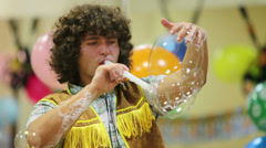 Man blows many soap bubbles on children party. Stock Footage