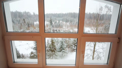 View from large window to snow forest in winter day Stock Footage
