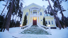 Entrance with stairs of two-storey country house among forest Stock Footage