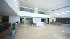 Spacious lighting empty reception hall in modern building Stock Footage