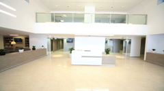 Front desk in reception hall in modern business center Stock Footage