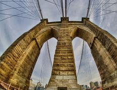 Powerful structure of Brooklyn Bridge in New York City at Winter - stock photo