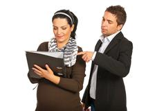 Manager boss with pregnant assistant Stock Photos