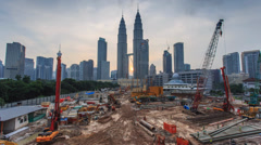 Petronas Twin Towers and a Construction Park Timelapse Stock Footage