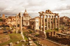 View of Roman Forum, focus on the Saturn's Temple in foreground. - stock photo