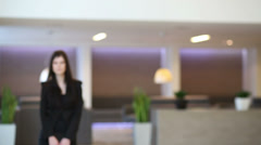 business woman in black suit goes in hall of business center - stock footage
